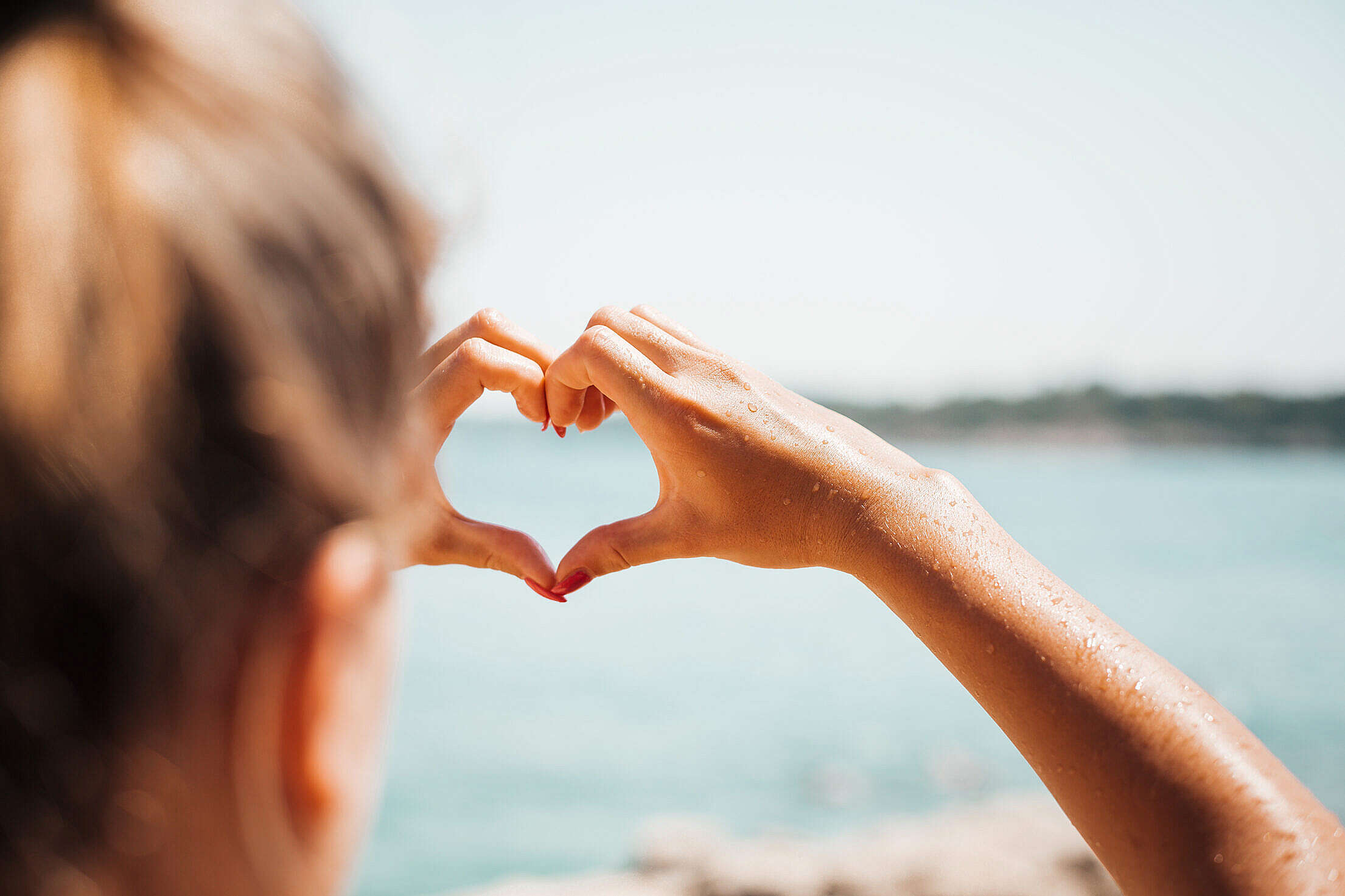 Hand Love Heart by the Sea Free Stock Photo