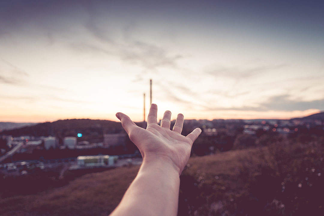 Download Hand Reaching The Sky FREE Stock Photo