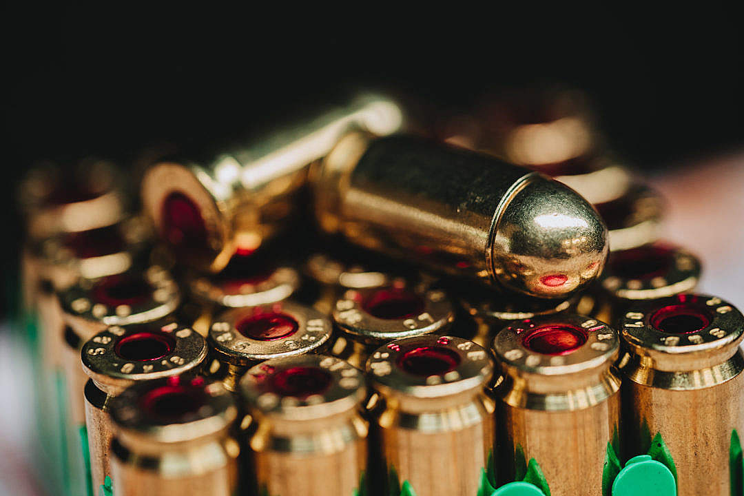 Download Handgun 9mm Luger Bullets FREE Stock Photo
