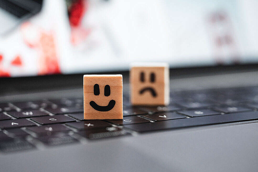 Download Happy and Sad Smiley on Laptop Keyboard FREE Stock Photo