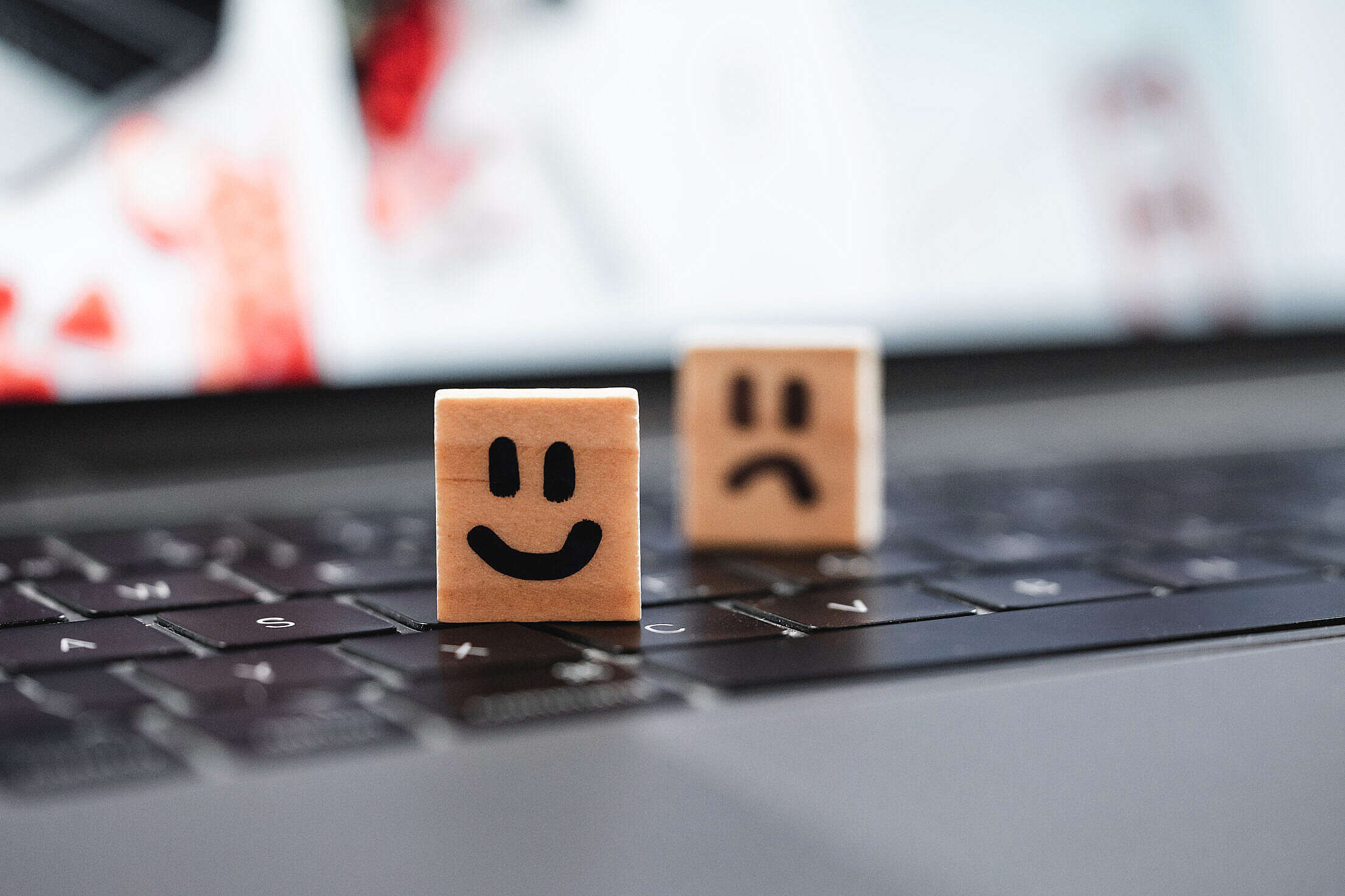 Happy and Sad Smiley on Laptop Keyboard Free Stock Photo