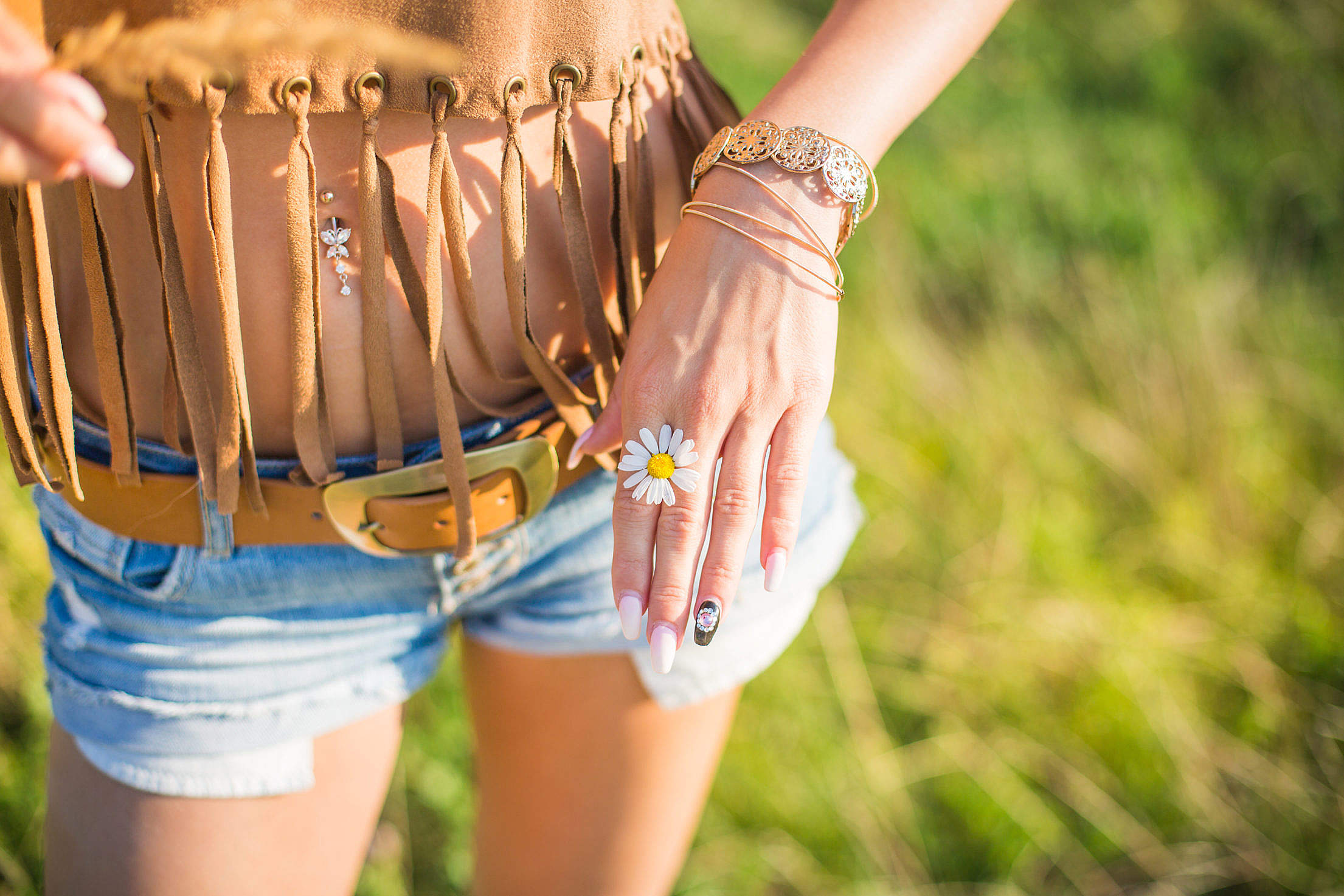 Happy Girl Showing a Daisy in Her Hands Free Stock Photo
