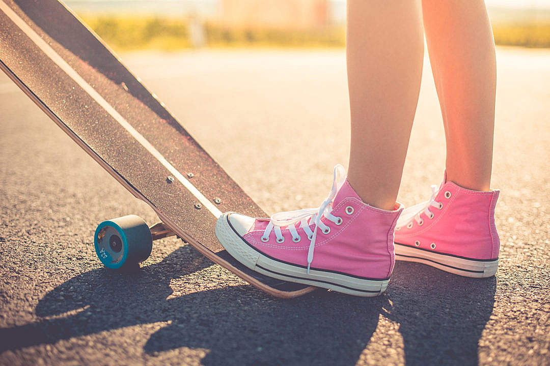Download Happy Girl with Pink Shoes Ready to Longboard Ride FREE Stock Photo