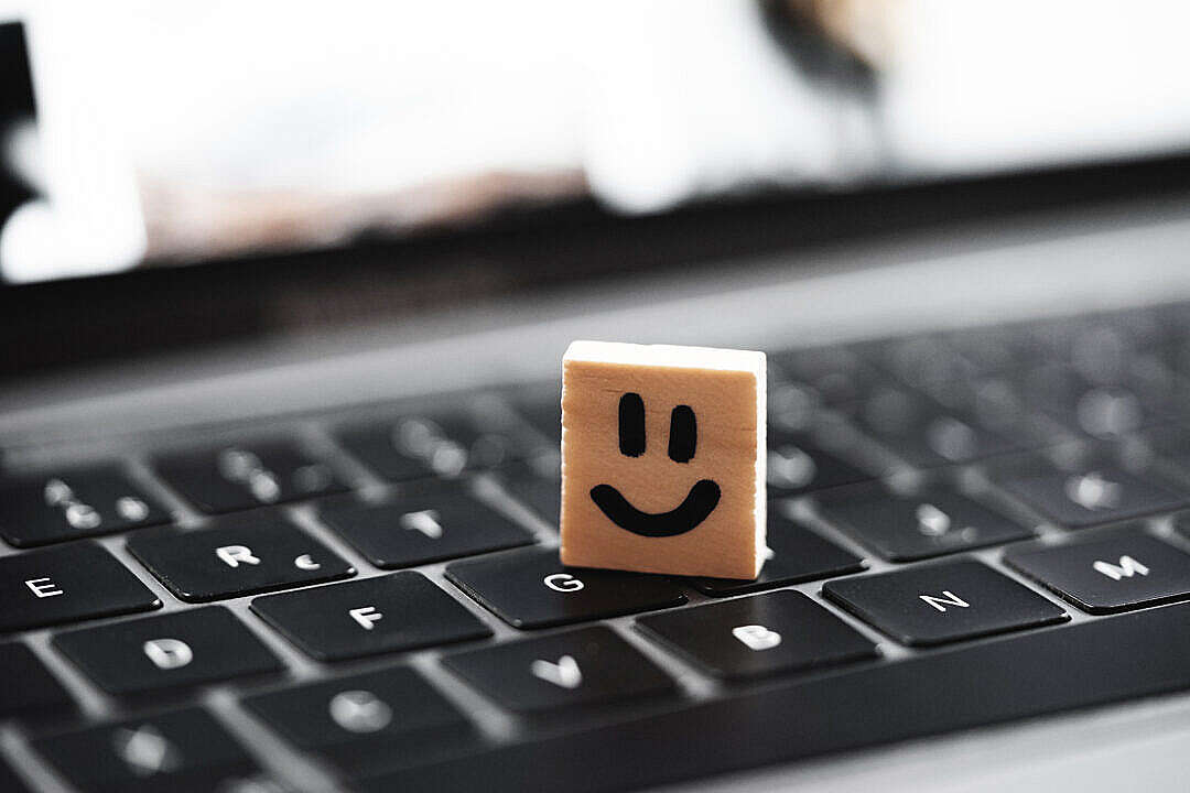 Download Happy Smiley on Laptop Keyboard FREE Stock Photo