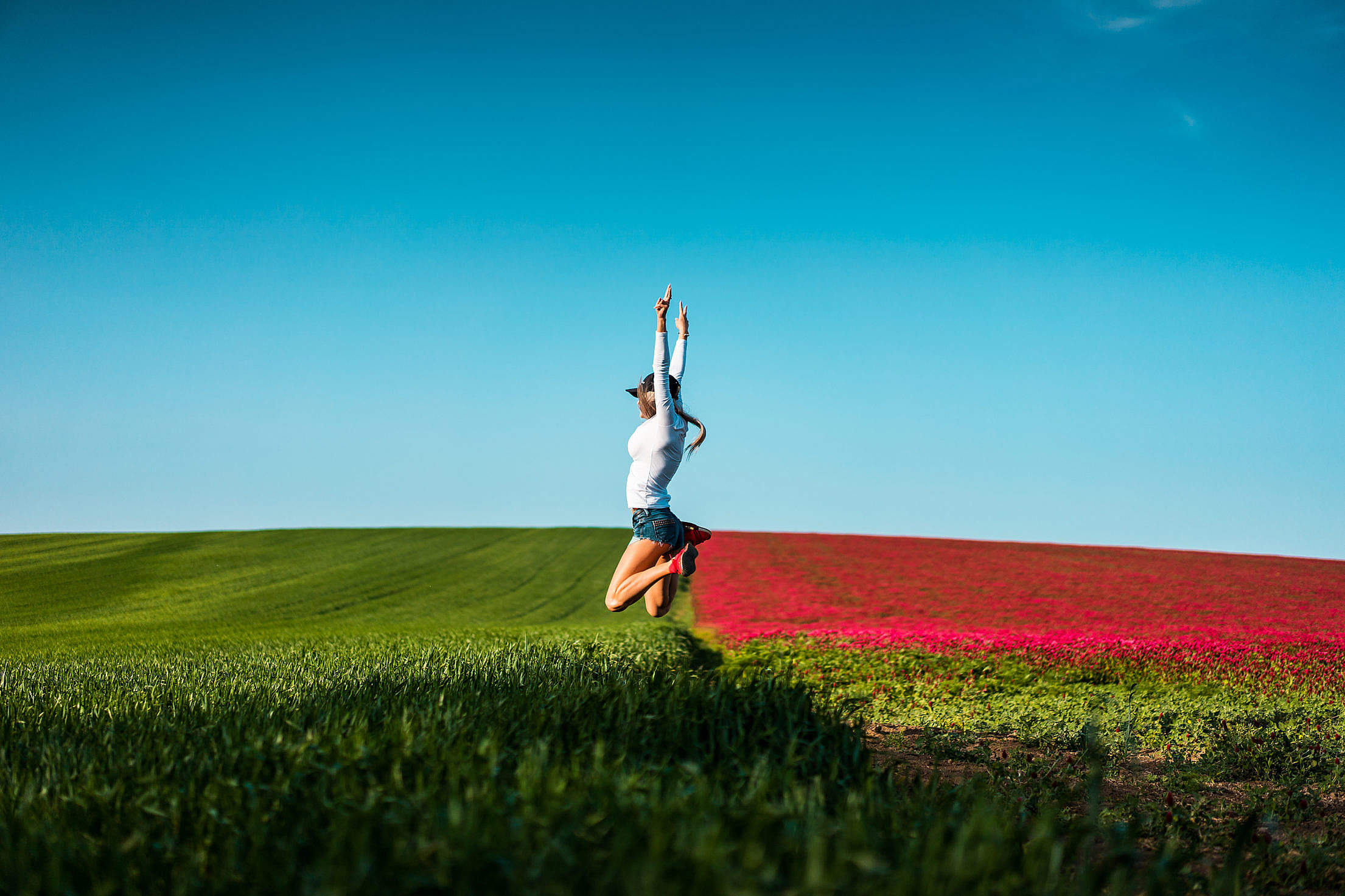 Happy Woman Jumping in the Air Free Stock Photo