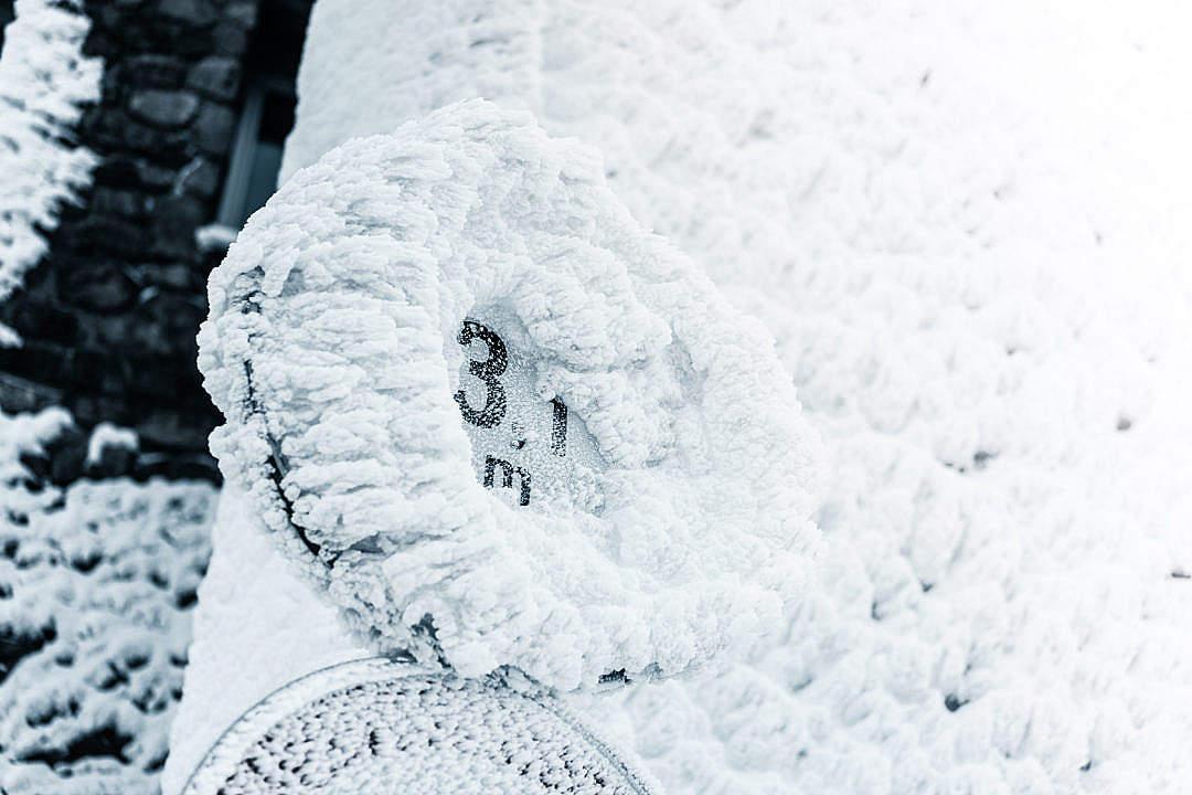 Download Hardcore Winter Frozen Road Sign FREE Stock Photo