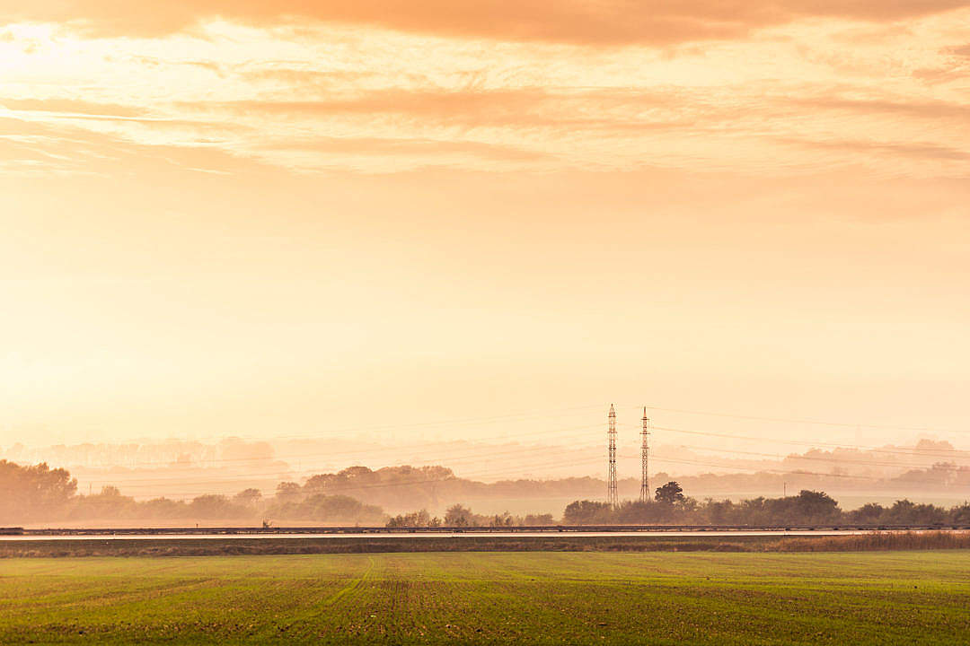 Download Highway Road and Electricity Pylons Foggy Golden Hour FREE Stock Photo