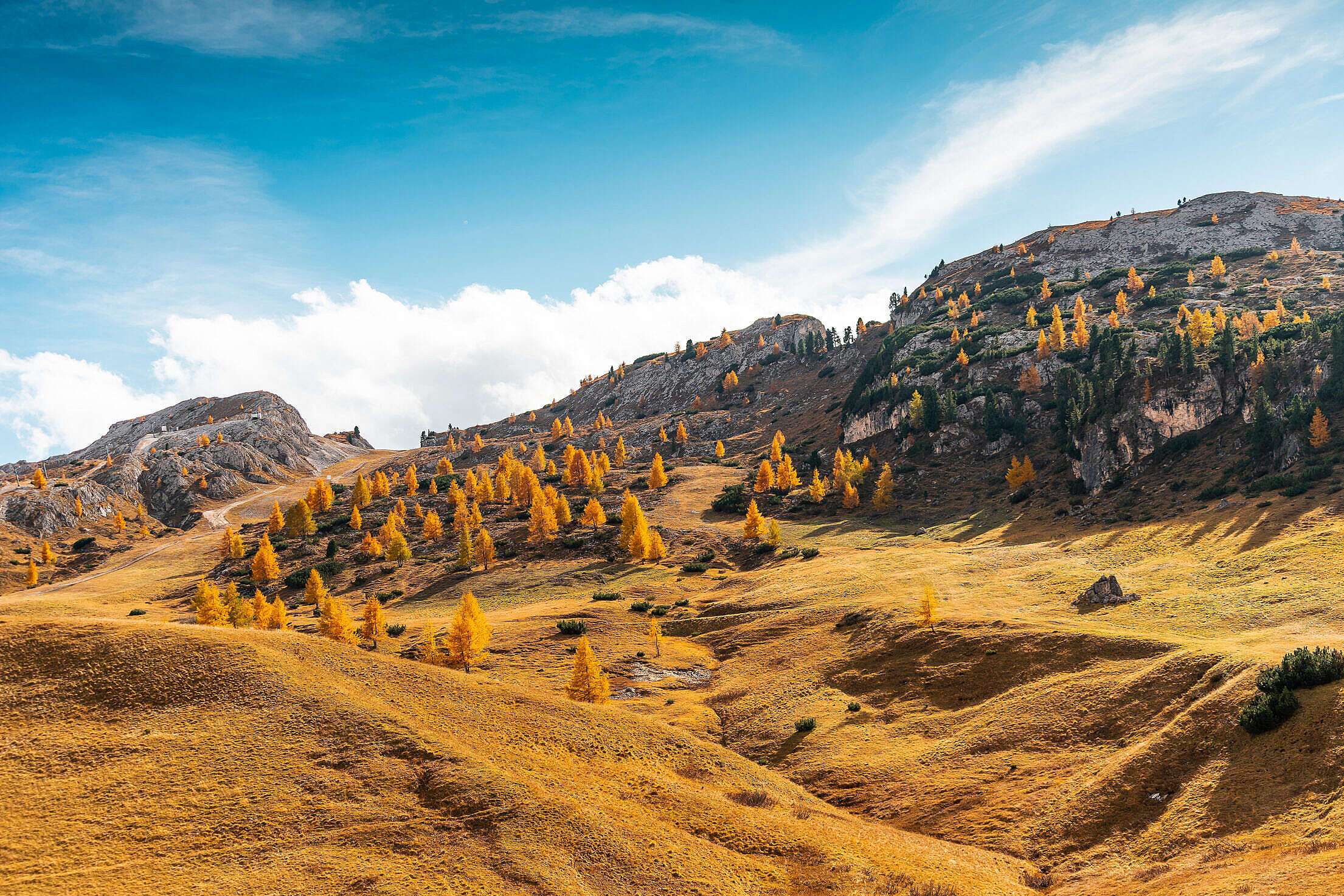 Hilly Landscape with a Dry Grass, Dolomites Free Stock Photo