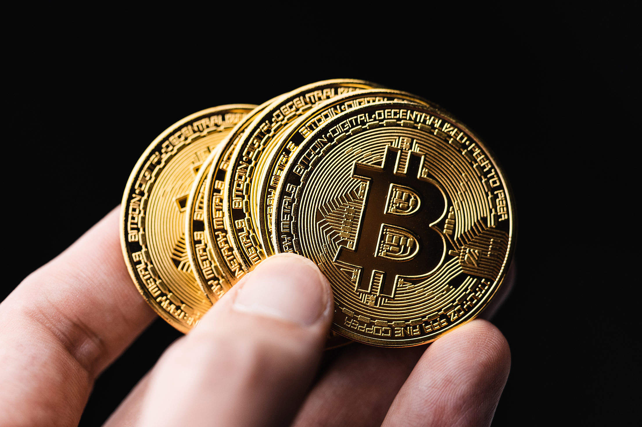 Holding Bitcoins in a Hand Free Stock Photo