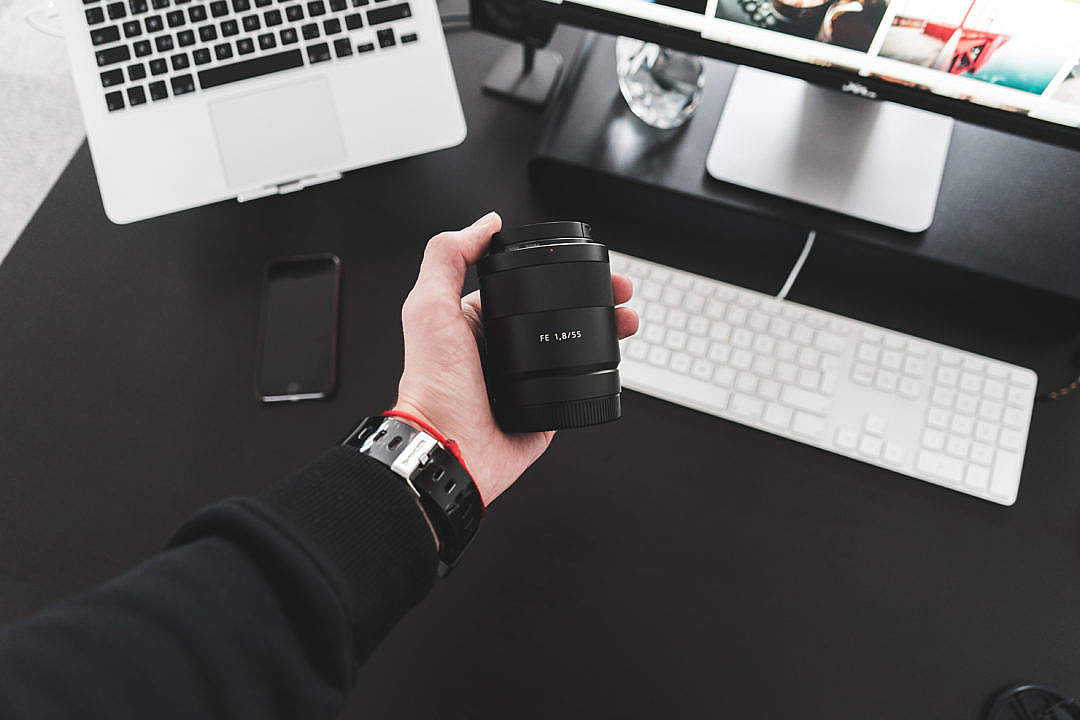 Download Holding Sony Zeiss Sonnar FE 55mm f/1.8 Lens in Hand #2 FREE Stock Photo