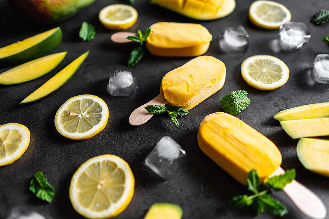 Download Homemade Mango Popsicles Decorated with Mint Leaves FREE Stock Photo