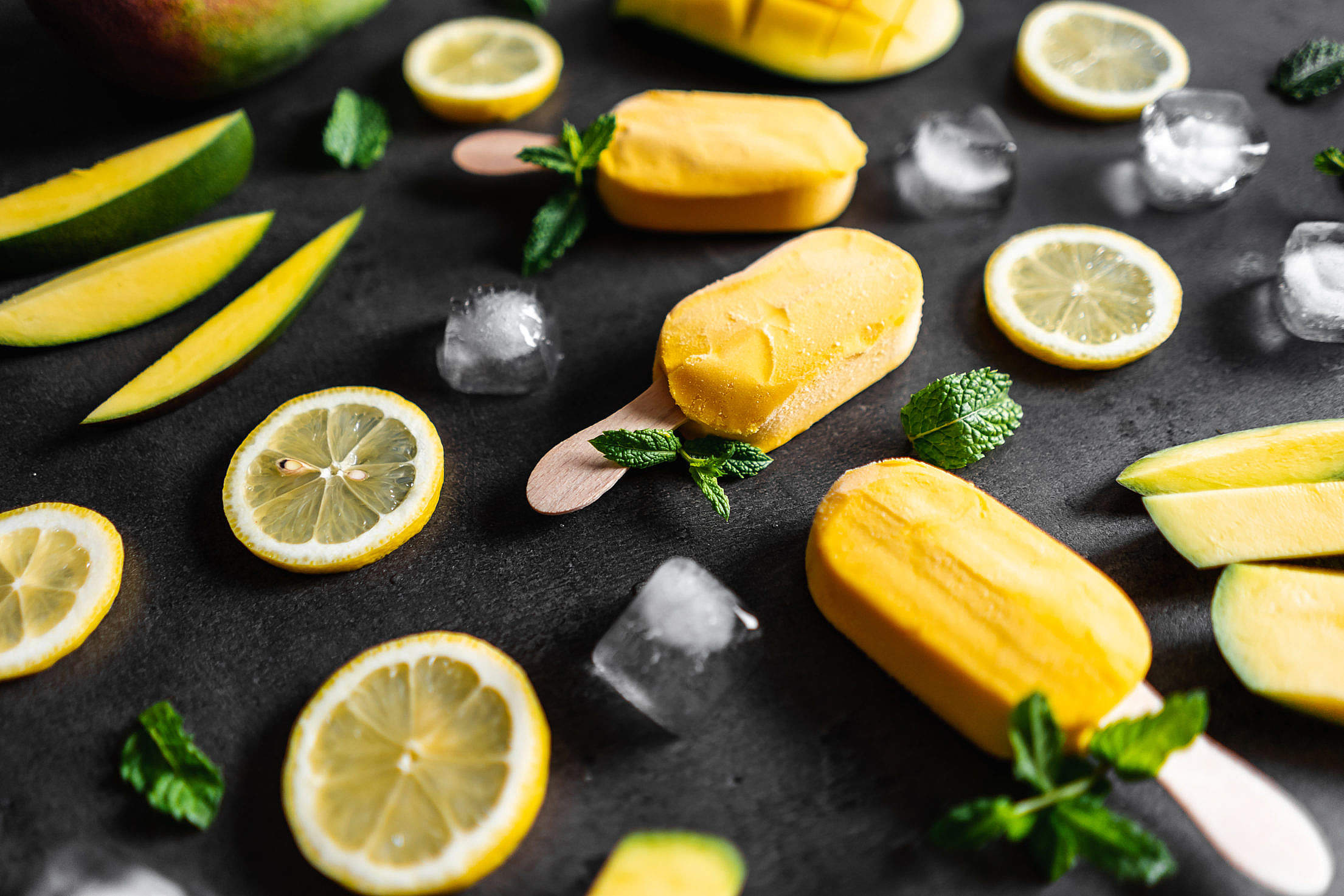 Homemade Mango Popsicles Decorated with Mint Leaves Free Stock Photo