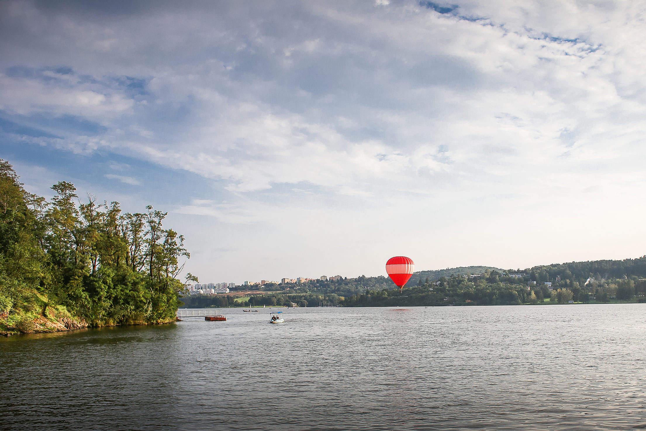 Hot Air Balloon over Lake Free Stock Photo