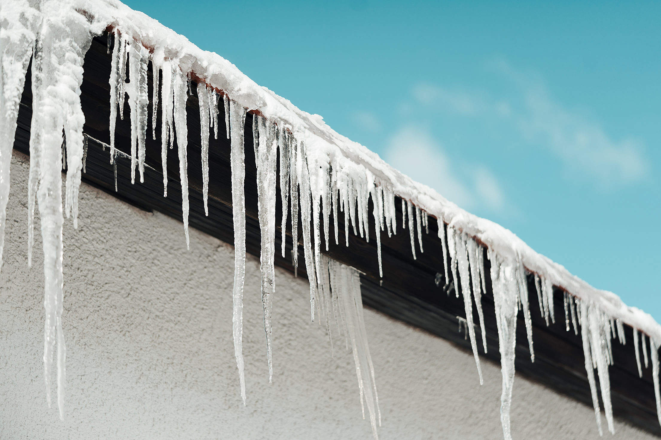 Icicles Hanging from Roof Free Stock Photo