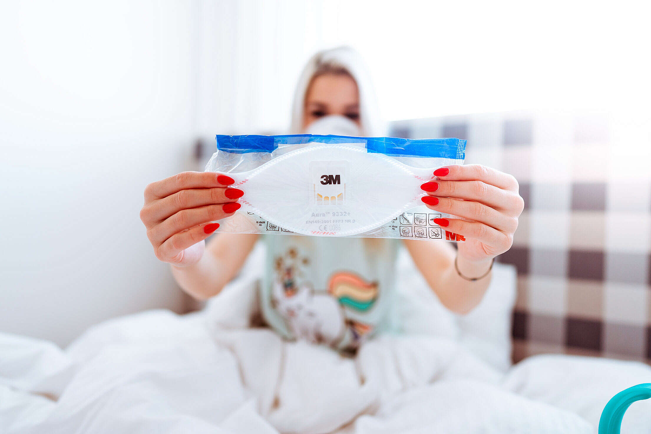 Ill Woman in Bed Showing FFP3 Respirator Against Coronavirus COVID-19 Free Stock Photo