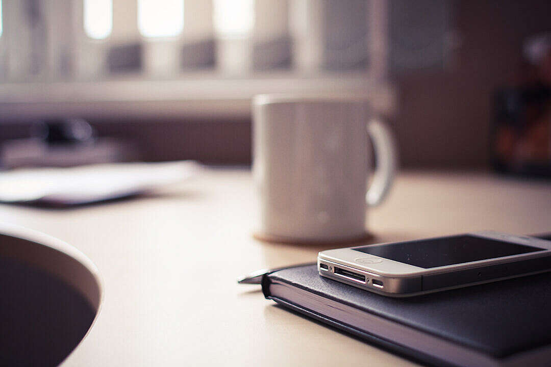 Download iPhone 4S with Brown Diary FREE Stock Photo