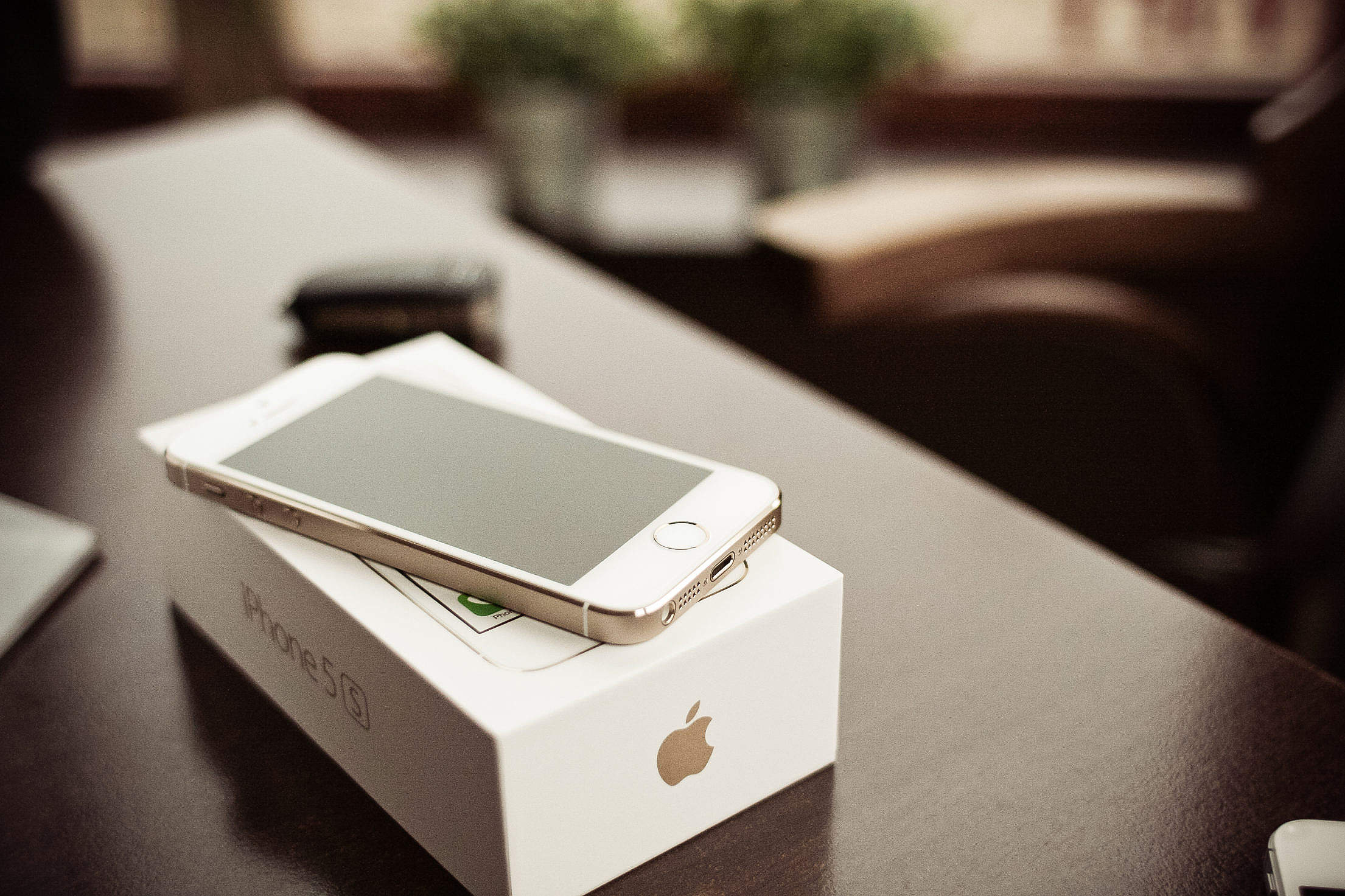 iPhone 5S Gold with a box Free Stock Photo