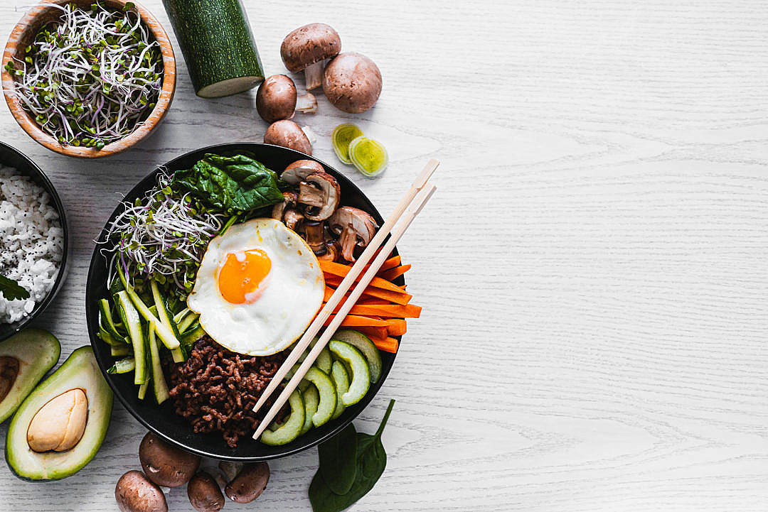 Download Korean Bibimbap on a White Table with a Space for Text FREE Stock Photo