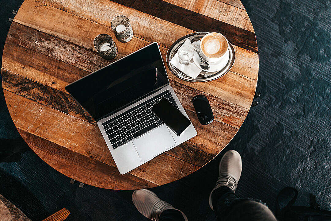 Download Laptop on a Round Wooden Table Flat Lay FREE Stock Photo