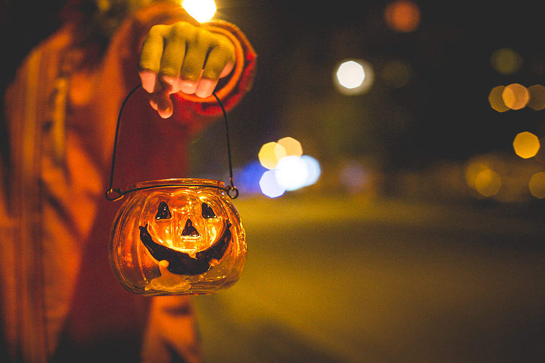 Download Little Girl Holding Halloween Candle Holder FREE Stock Photo