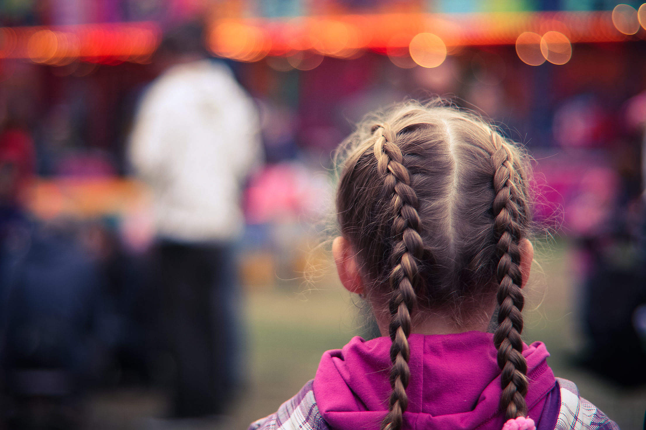 Little Girl in Amusement Park Free Stock Photo
