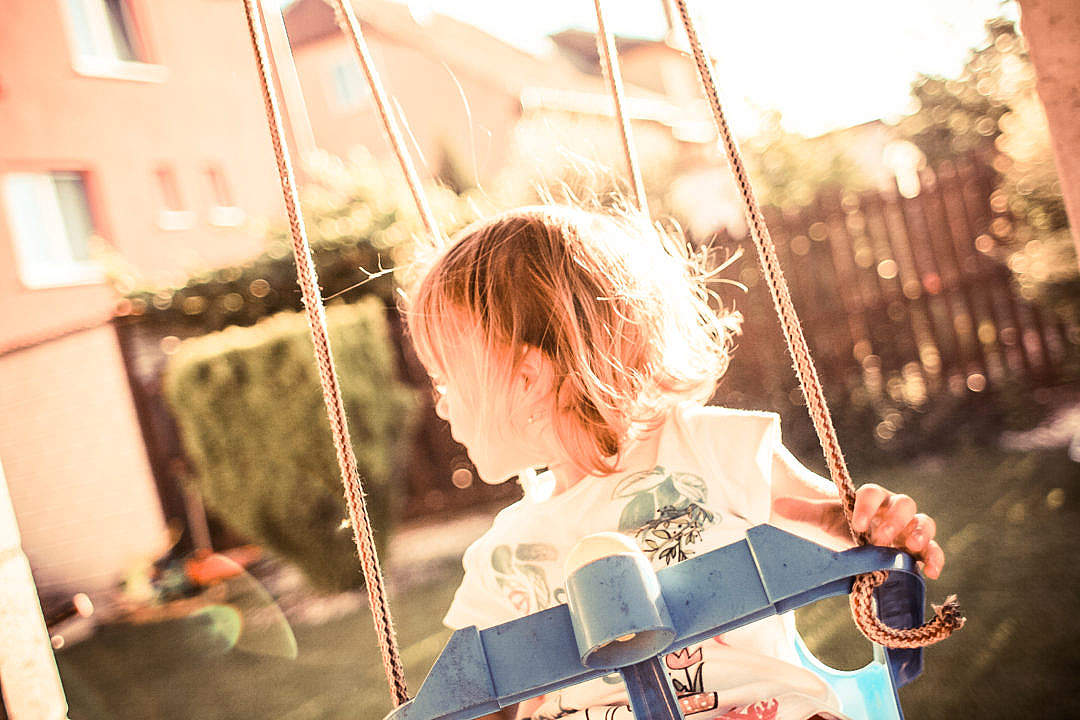 Download Little Girl on a Swing FREE Stock Photo