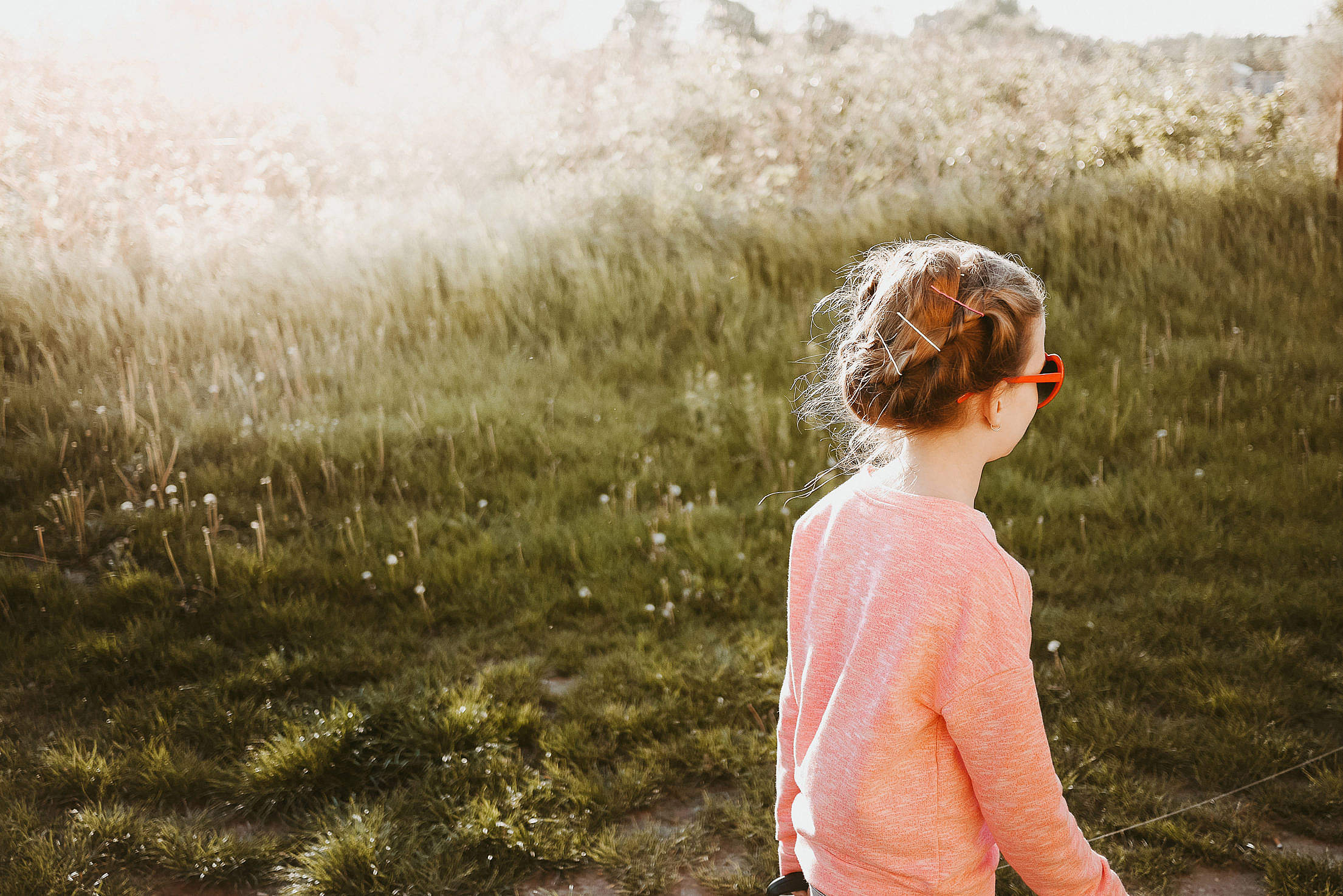 Little Girl Walking in The Meadow Free Stock Photo
