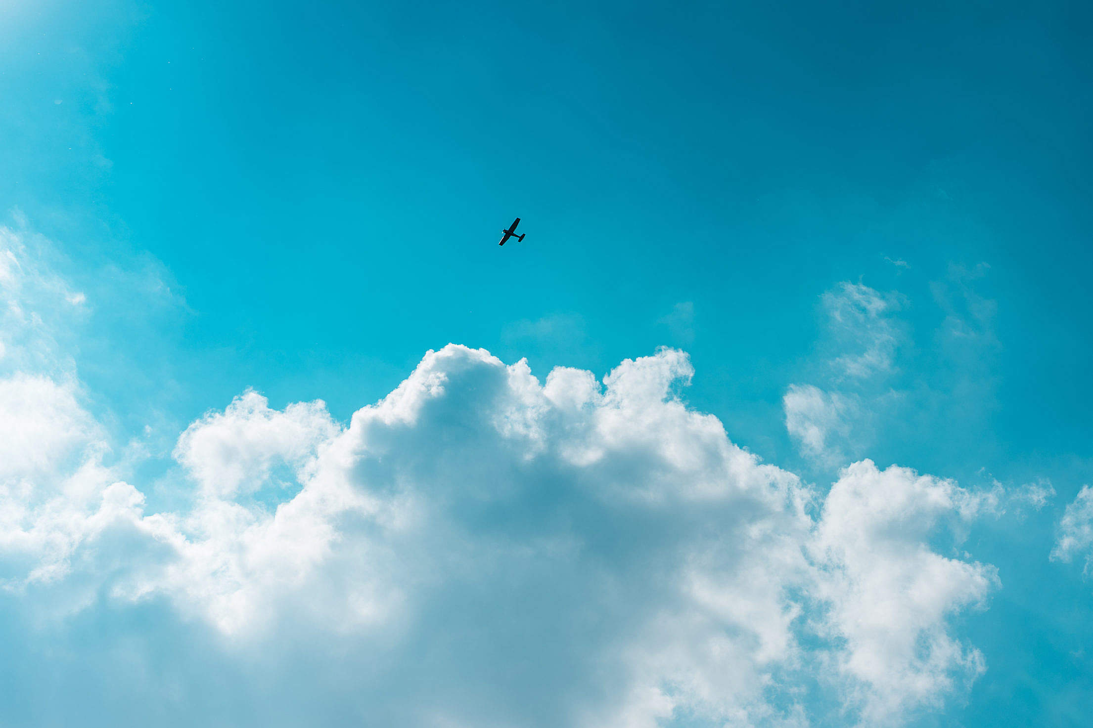 Little Plane Above The Clouds Free Stock Photo