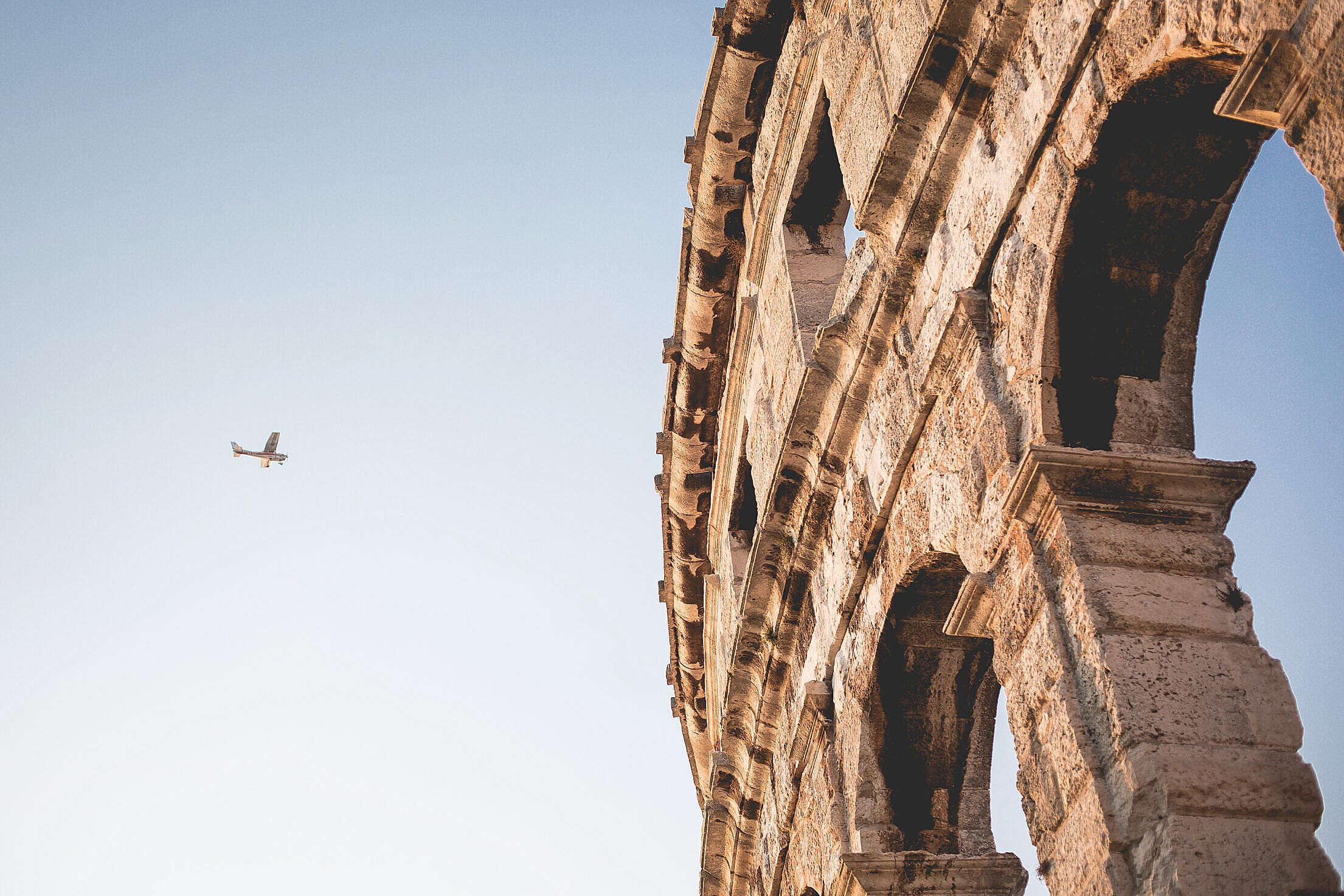 Little Plane and Roman Arena in Pula, Croatia Free Stock Photo