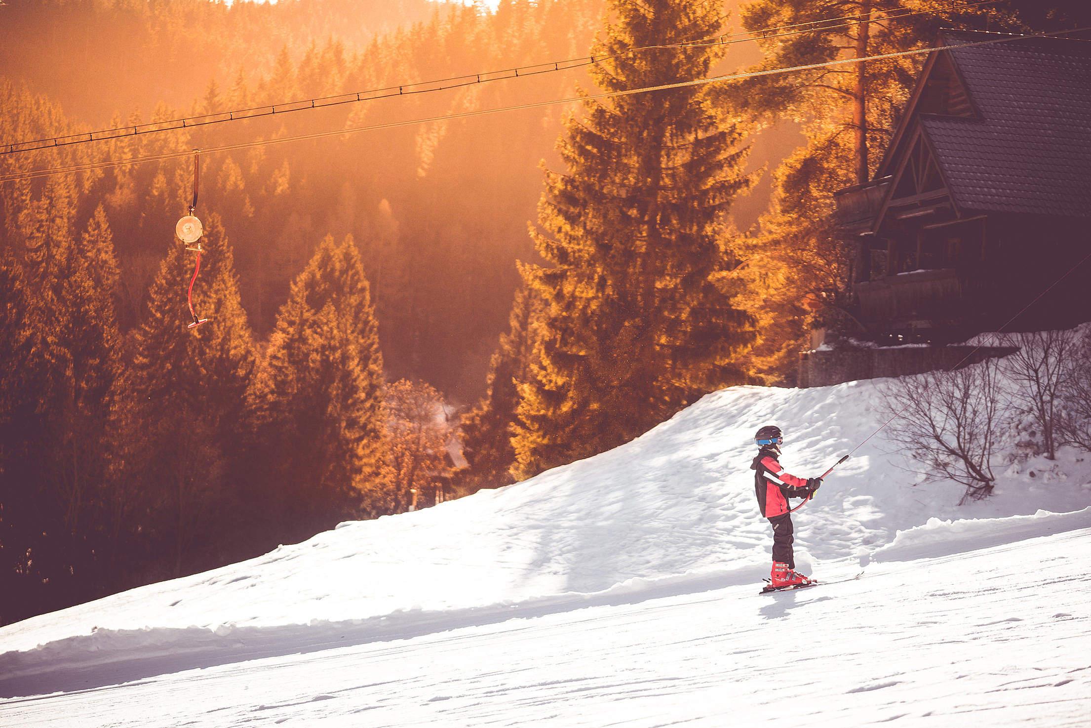 Little Skier On a Ski Lift Free Stock Photo