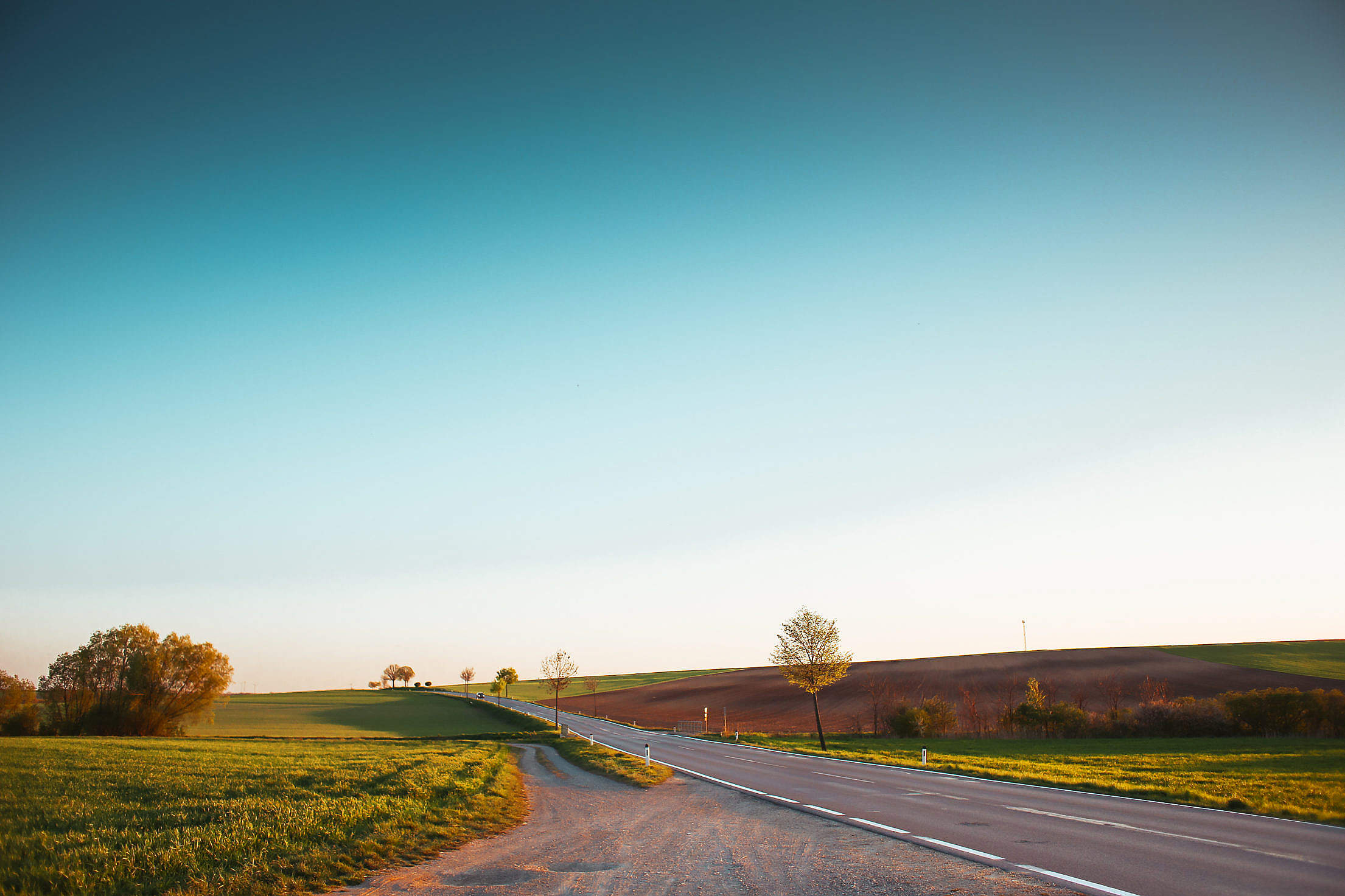 Long Road and Cloudless Sky Free Stock Photo