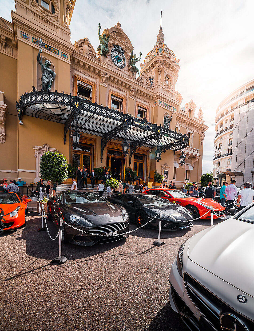 Download Luxury Cars and Tourists in front of Monaco Casino FREE Stock Photo