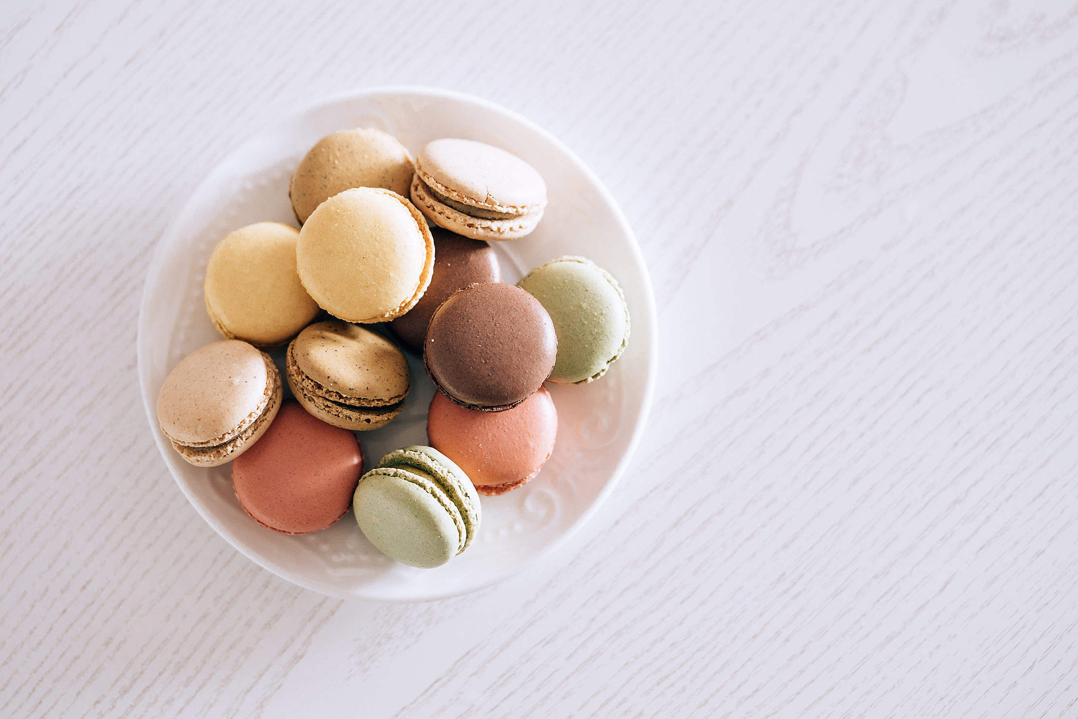 Macarons in Pastel Colors on The White Wood Free Stock Photo