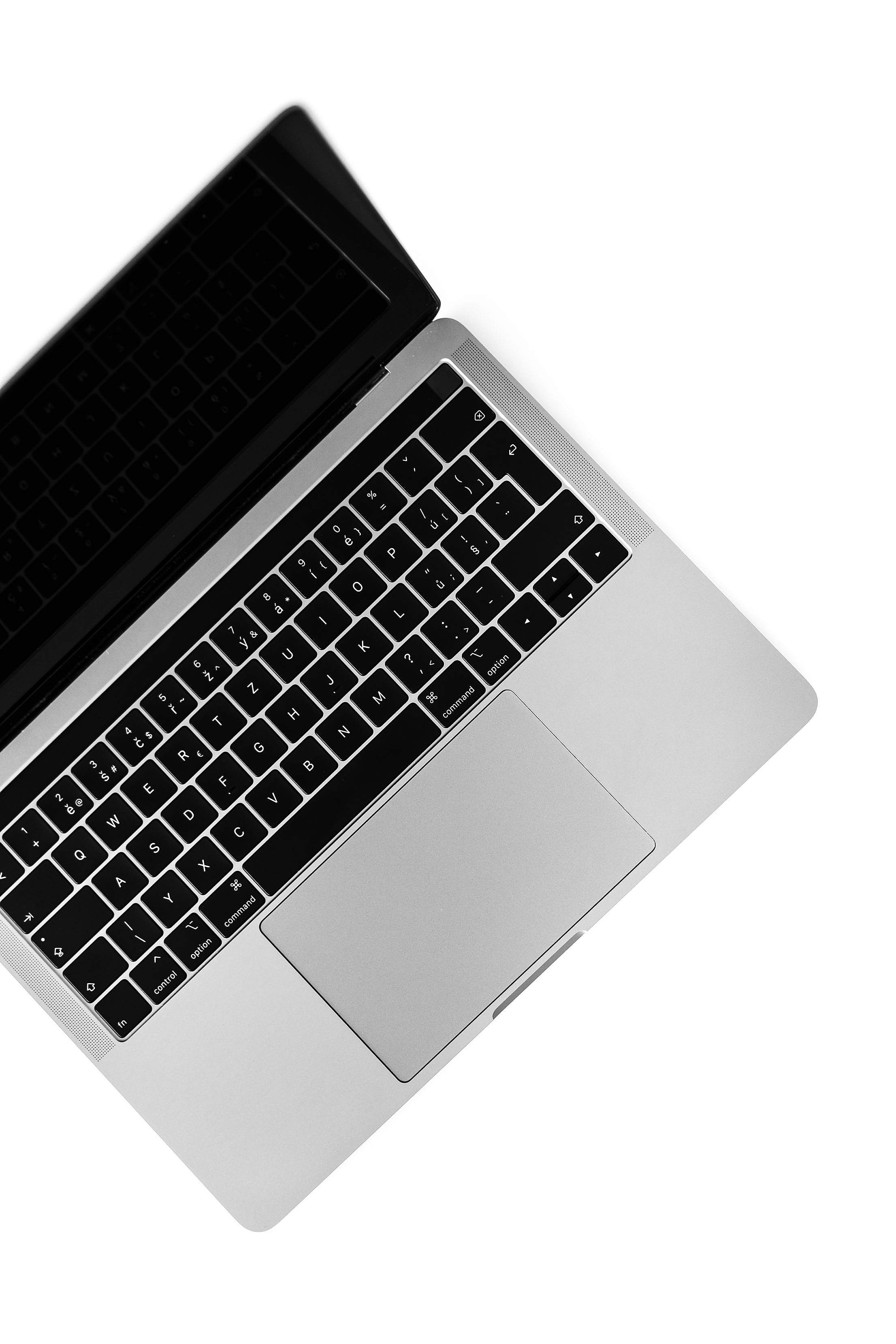MacBook Pro Isolated on a White Background Free Stock Photo