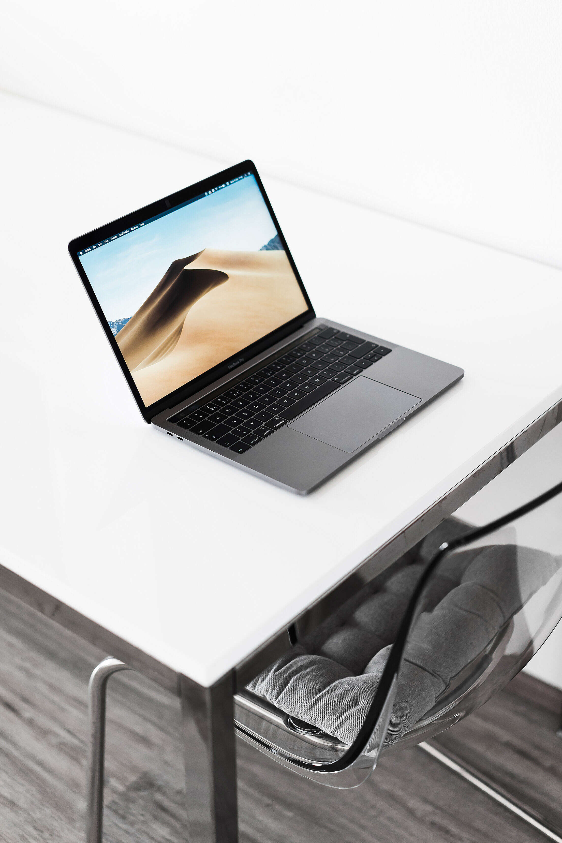 MacBook Pro on White Table at Home Free Stock Photo