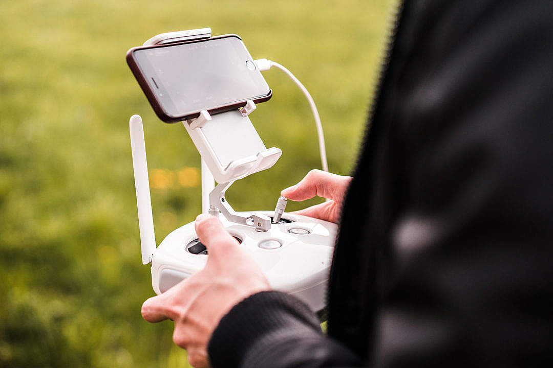 Download Male Pilot Controlling FPV Drone with Smarphone #2 FREE Stock Photo
