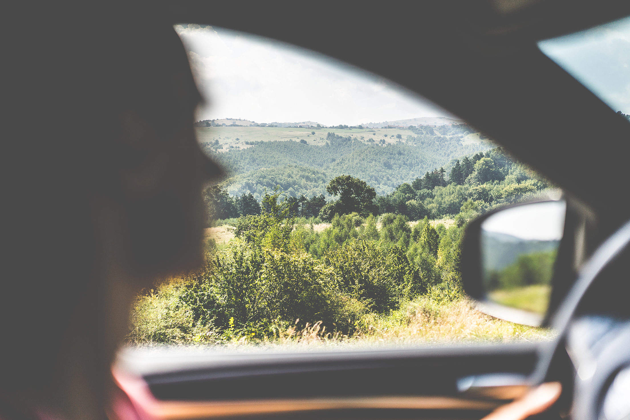 Man Driving a Car in Countryside Free Stock Photo