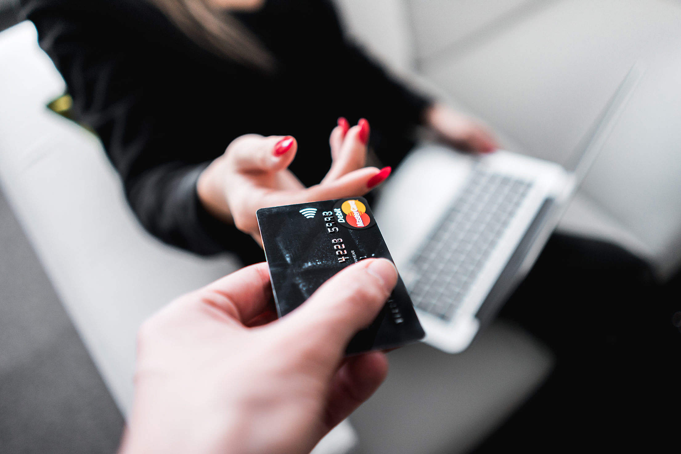 Man Giving His Credit Card to a Woman Free Stock Photo