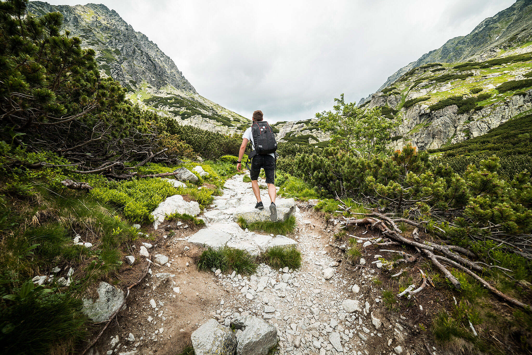 Man Hiking Alone in Mountains Free Stock Photo