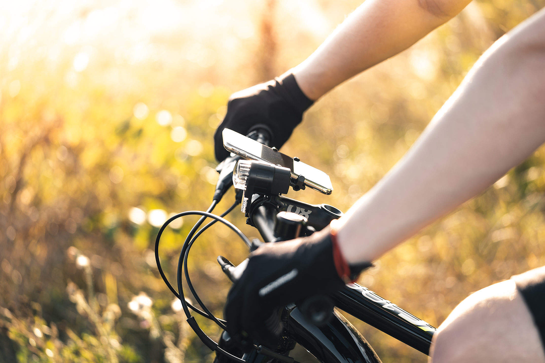 Man Holding a Bicycle Handlebar Free Stock Photo