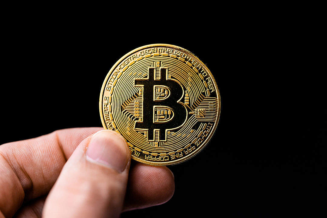 Download Man Holding a Bitcoin Coin FREE Stock Photo