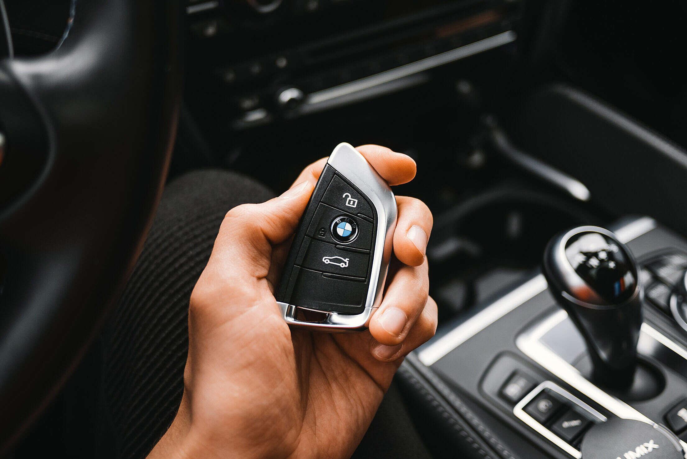 Man Holding a BMW M Sport Car Key Free Stock Photo