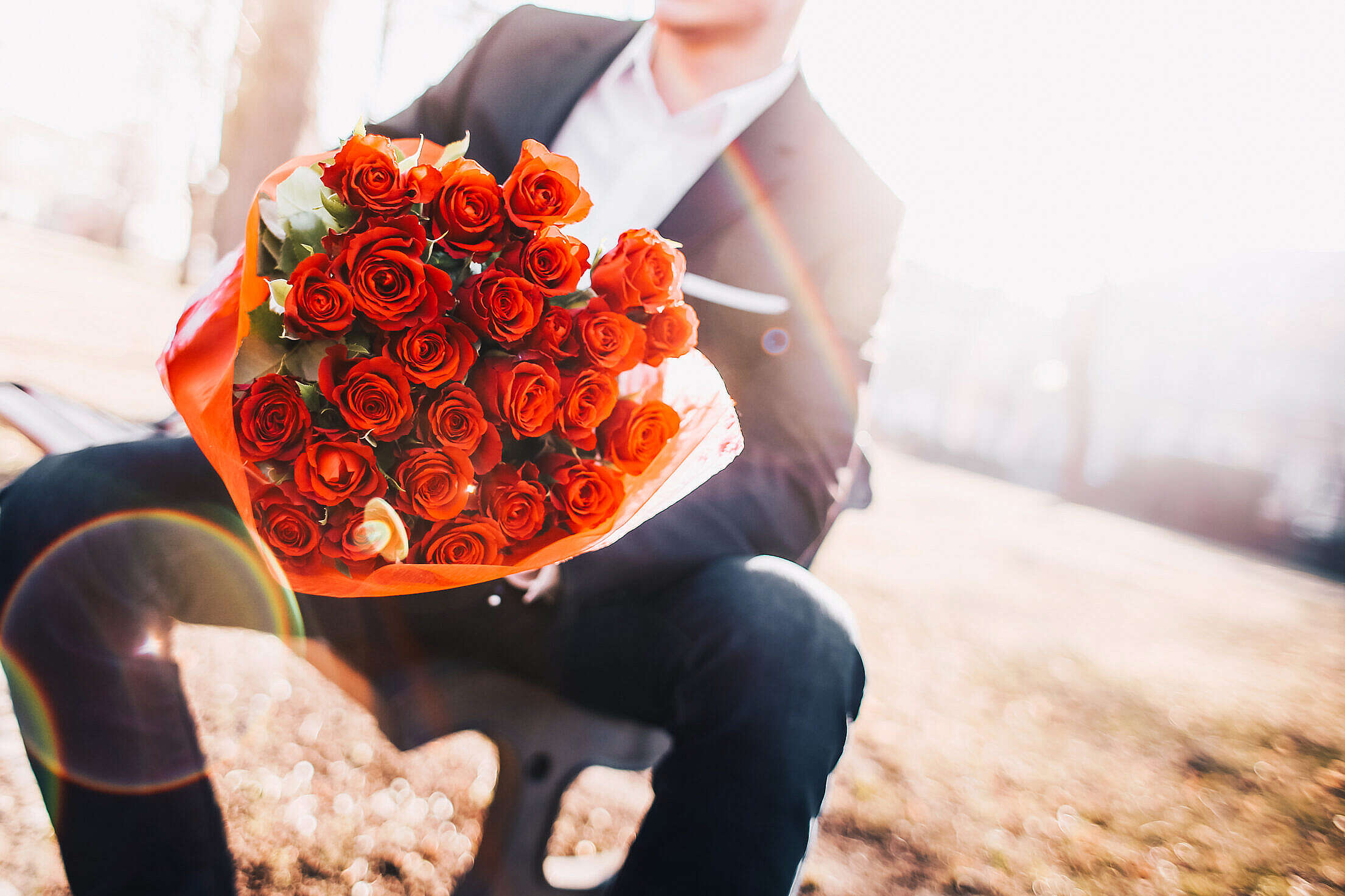 Man Holding a Bouquet of Red Roses Free Stock Photo