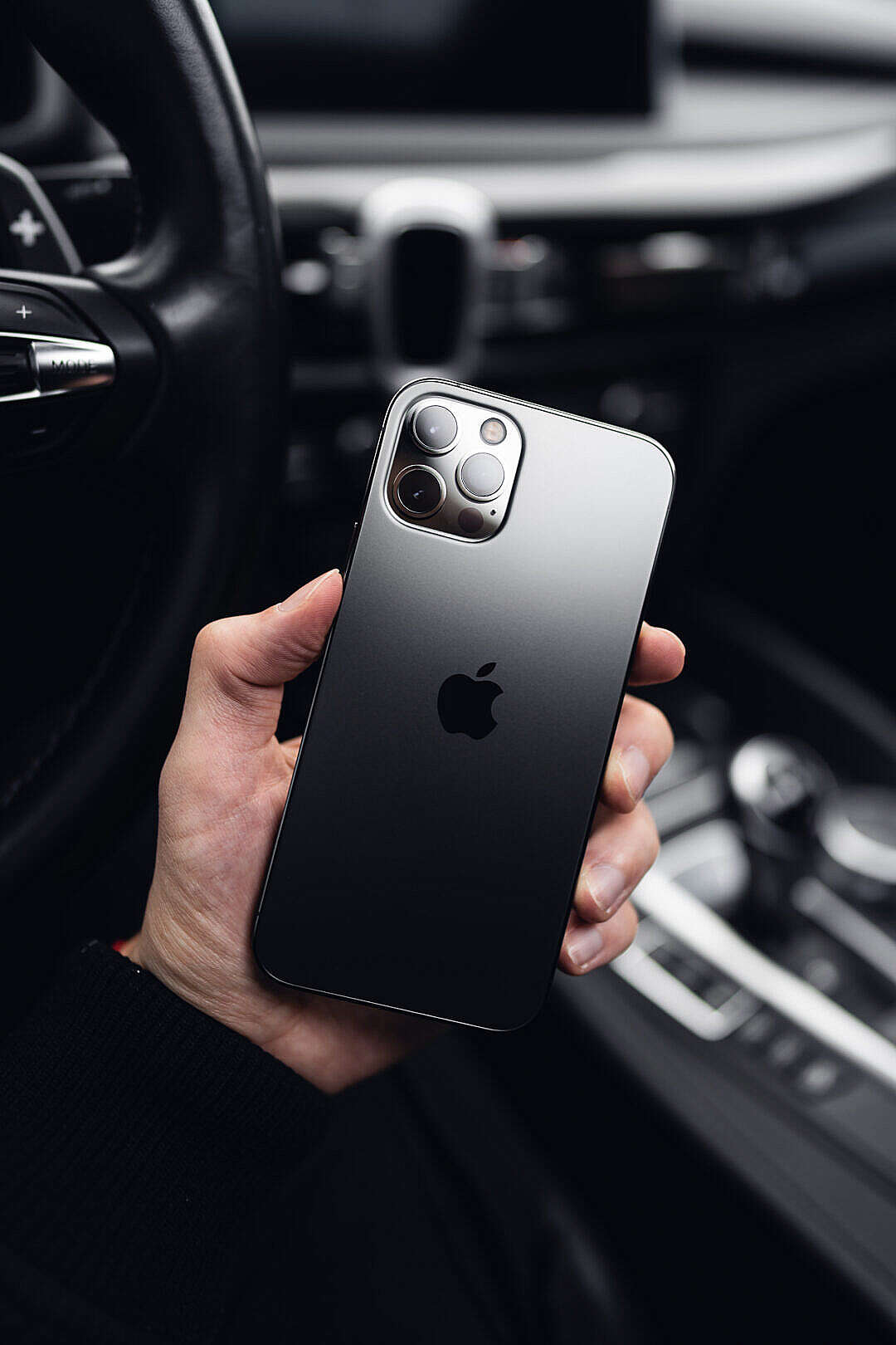 Download Man Holding a New iPhone 12 Pro FREE Stock Photo