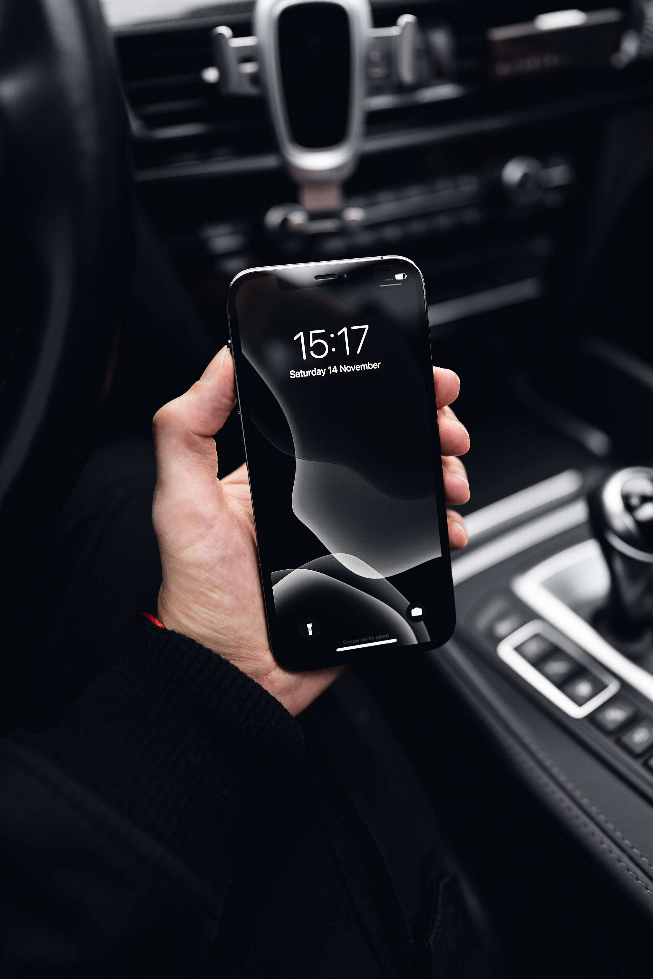 Man Holding a New Smartphone in a Hand Free Stock Photo