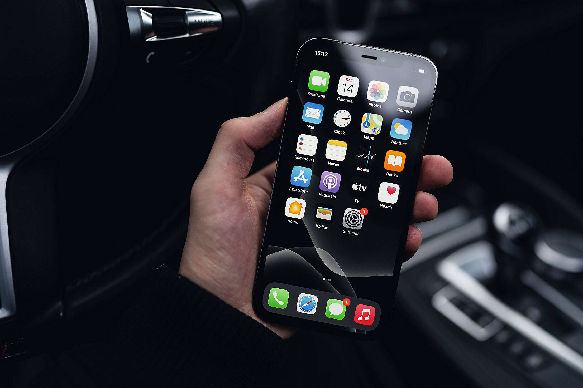 Man Holding a Smartphone in a Car Free Stock Photo