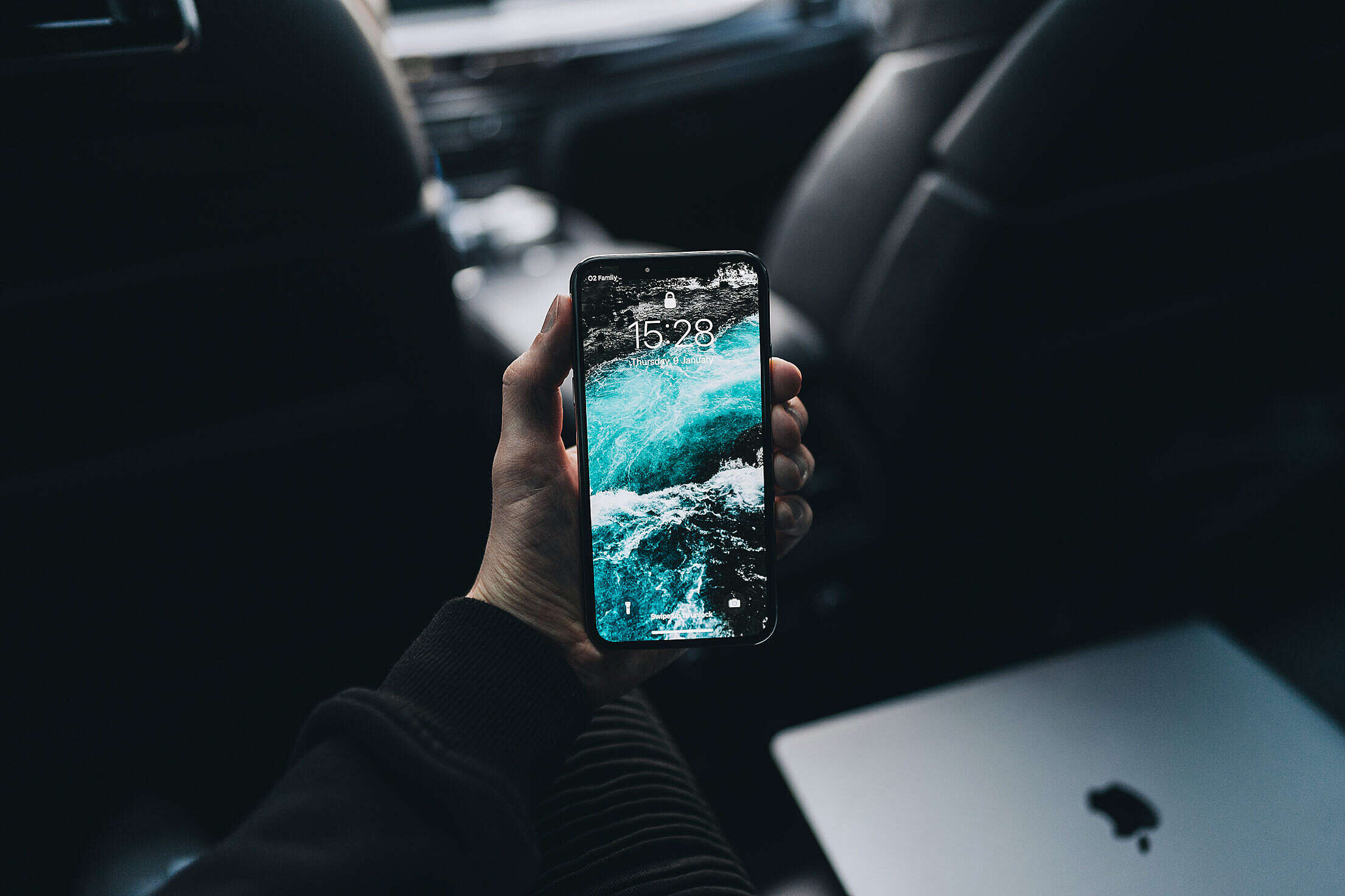 Man Holding an iPhone in His Hand Free Stock Photo