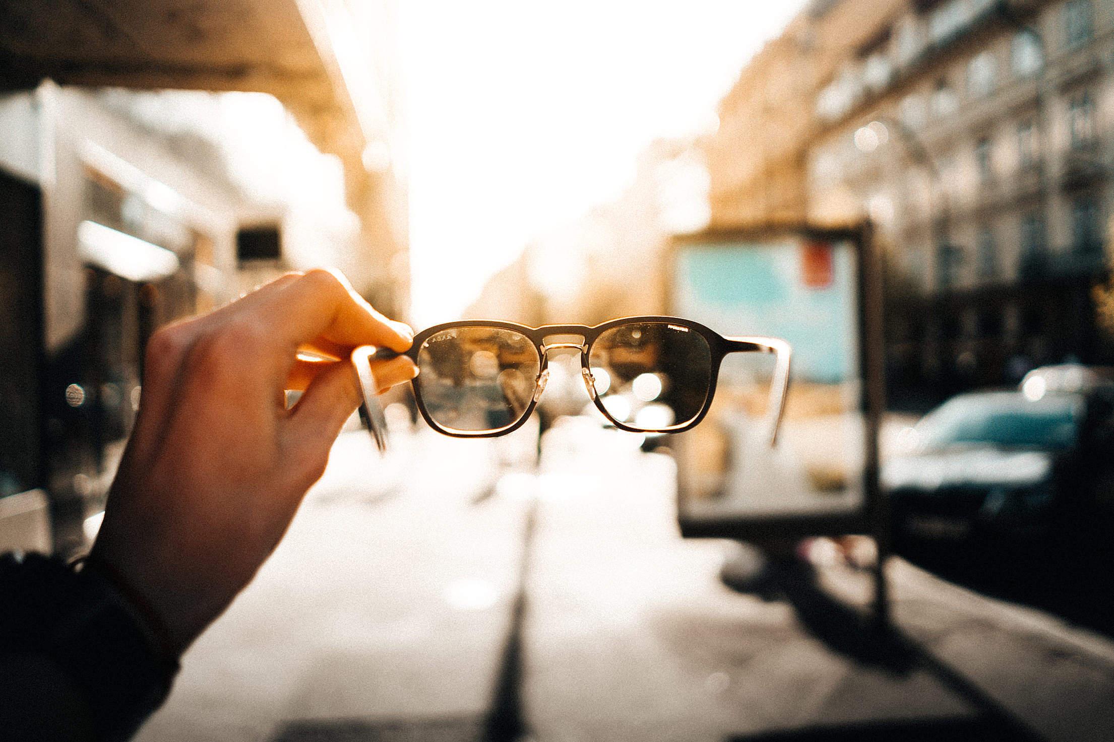 Man Holding Sunglasses Free Stock Photo
