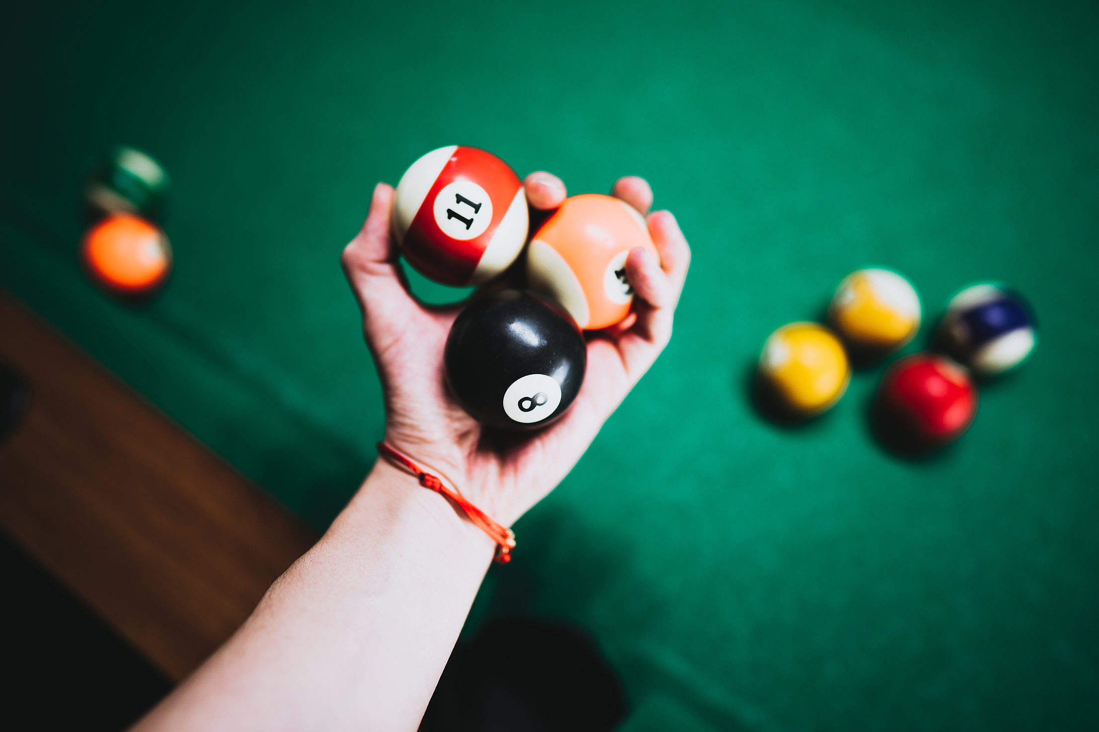 Man Holding Vintage Billiard Balls in His Hand Free Stock Photo