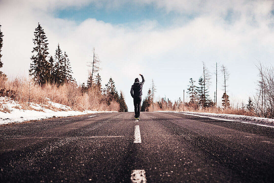 Download Man in a Winner Pose Walking on the Road FREE Stock Photo